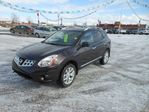 2012 Nissan Rogue SL AWD CVT,2.5L inline 4 engine,navagation,rear camera,moon roof,A/C,cruse control,cd player,power windows/locks/seats,leather seats also heated,fog lamps,mud flaps in Dawson Creek, British Columbia
