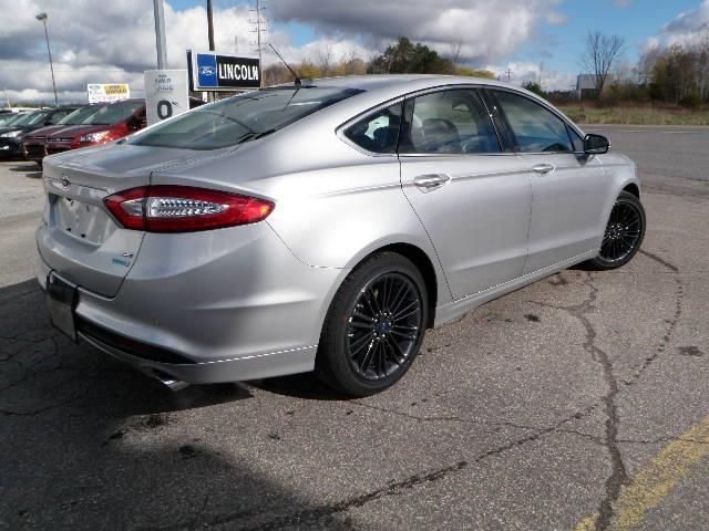 Silver Ford Fusion With Black Rims