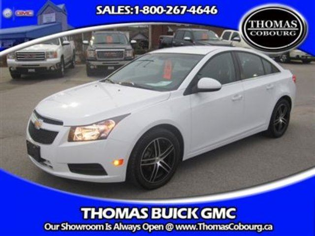2014 chevrolet cruze 1lt with two sets of rims tires white thomas buick gmc. Black Bedroom Furniture Sets. Home Design Ideas