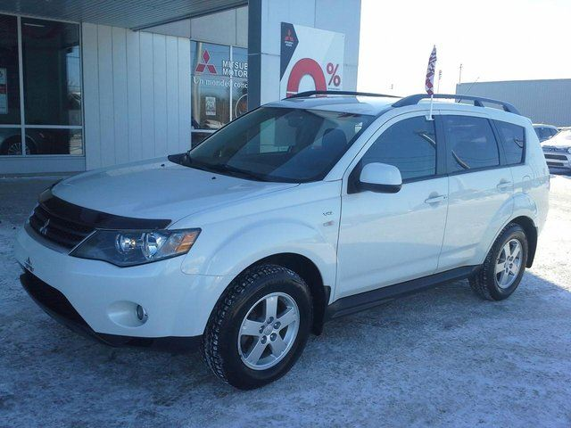2009 mitsubishi outlander ls awd v6 awd 7 passagers white groupe beaucage. Black Bedroom Furniture Sets. Home Design Ideas