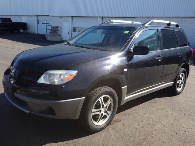 2006 mitsubishi outlander ls black k w mitsubishi motors. Black Bedroom Furniture Sets. Home Design Ideas