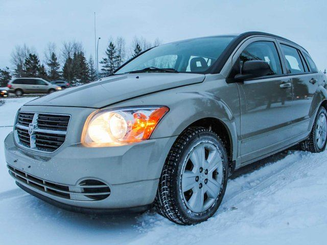 2009 dodge caliber sxt front wheel drive gold southtown. Black Bedroom Furniture Sets. Home Design Ideas