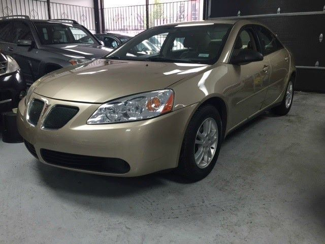 2006 pontiac g6 gold lion autos enterprise. Black Bedroom Furniture Sets. Home Design Ideas