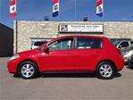 2012 Nissan Versa 1.8 SL COMES FULLY MECHANICALLY SAFETY CERTIFIED A in Calgary, Alberta