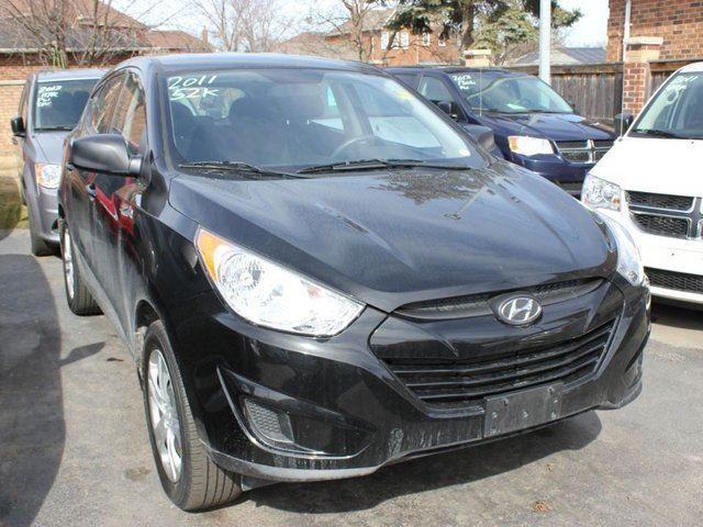 2011 hyundai tucson gl black 9 auto sales. Black Bedroom Furniture Sets. Home Design Ideas