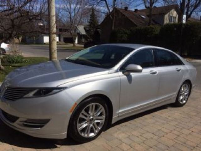 Lincoln Mkz Lease >> 2015 Lincoln MKZ Hybrid, Electric motor, Prepaid Maintenance!! Silver | LEASE BUSTERS | Wheels.ca