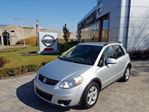 1643 Suzuki SX4  AWD AC+VITRES+MAGS in Longueuil, Quebec