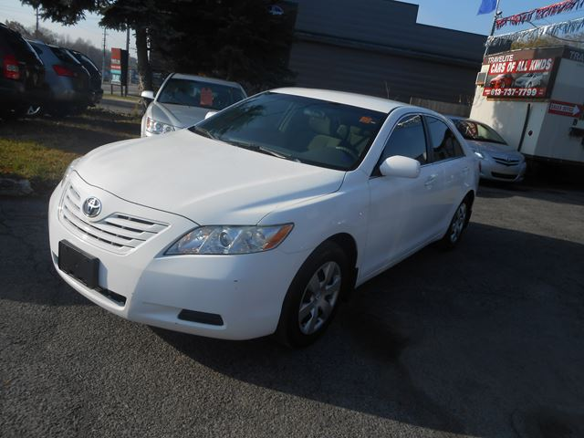 2009 toyota camry le white cars of all kinds. Black Bedroom Furniture Sets. Home Design Ideas