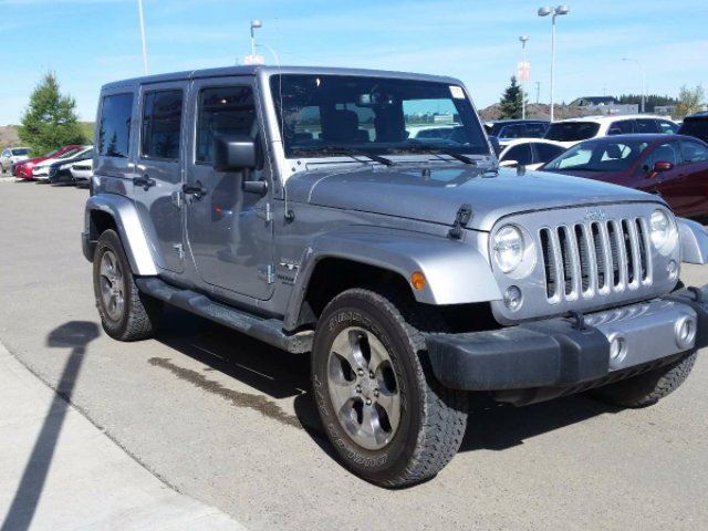 2016 jeep wrangler unlimited sahara red deer alberta used car for sale 2725446. Black Bedroom Furniture Sets. Home Design Ideas