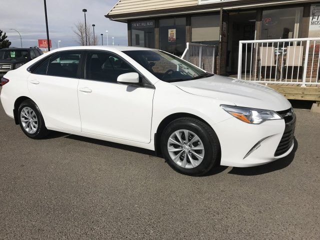 2016 TOYOTA CAMRY LE, BALANCE OF FACTORY WRRANTY in Lethbridge, Alberta