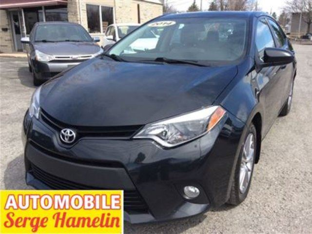 2014 Toyota Corolla LE camera recule bluetooth usb toit electrique in Chateauguay, Quebec