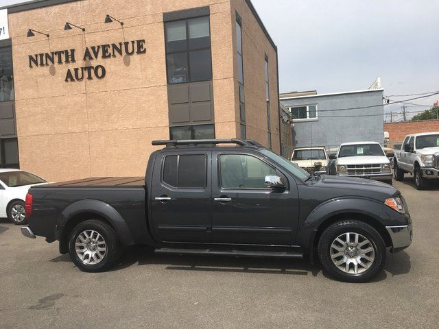 2010 Nissan Frontier LE 4x4 Crew Cab, Leather, Sunroof, Box cover in Calgary, Alberta
