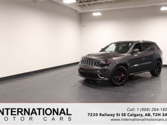 2014 JEEP GRAND CHEROKEE SRT8 SUPERCHARGED! BLOWOUT PRICING!! in Calgary, Alberta