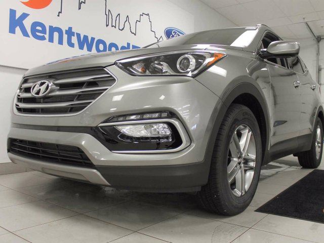 2017 HYUNDAI SANTA FE 2.4 Premium AWD with heated leather seats all around, a heated steering wheel and a back up cam in Edmonton, Alberta