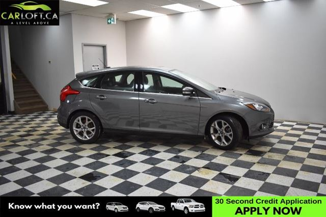 2013 FORD FOCUS Titanium- NAV * BACKUP CAM * LEATHER  in Kingston, Ontario