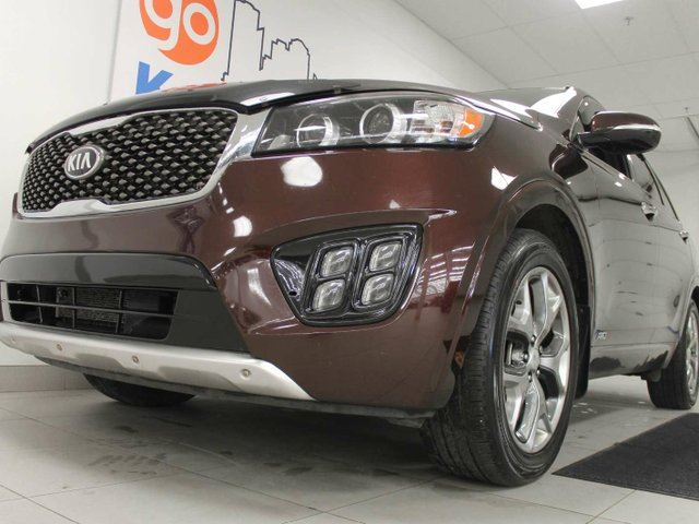 2016 KIA SORENTO SX AWD with it all- NAV, sunroof, heated/cooled power leather seats and heated leather steering wheel, heated leather rear seats, back up cam and power liftgate in Edmonton, Alberta
