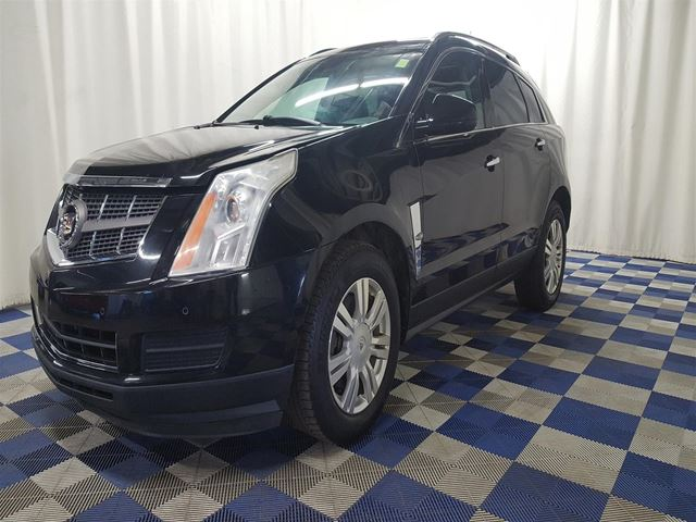 2010 CADILLAC SRX LEATHER/BLUETOOTH/SUNROOF/HTD SEATS! in Winnipeg, Manitoba