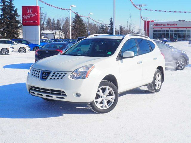 2010 NISSAN Rogue SL. AWD. Sunroof. Heated Leather Seats. Traction Control. Bose Audio. HomeLink. Compass. A/W Mats. Power Mirrors and Tinted Windows. in Edmonton, Alberta
