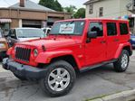 2013 Jeep Wrangler Unlimited Sahara 4x4 6spd Hardtop Convertible  in St Catharines, Ontario