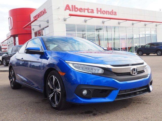 2016 HONDA Civic Touring. Eco. Low KMs. Accident Free. Moonroof. Back-Up Cam. Honda Remote Starer. Navigation. Honda Sensing. Heated Leather Seats. Wireless Phone Charging. Dual-Zone Climate. in Edmonton, Alberta